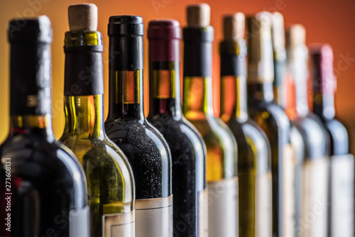 Line of wine bottles. Close-up.