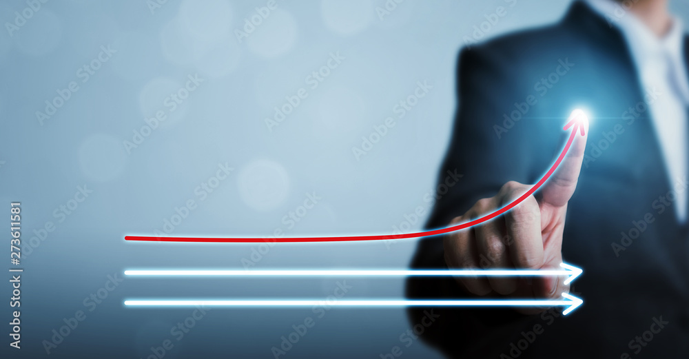 Fototapeta Businessman pointing arrow moving up growing business growth. Concept of corporate success, influencer, opinion leader, benchmark and think different