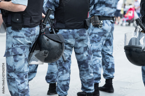 Canvas Print Police squad with helmets, body armor and batons close-up
