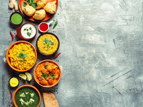 Photo  Indian cuisine dishes: tikka masala, dal, paneer, samosa, chapati, chutney, spices