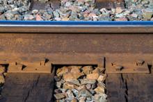Steel Rail Closeup With Spikes, Ties, Plate, Stone Ballast
