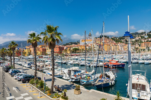 Foto auf Gartenposter Rosa dunkel View of palm tree and harbor with boats in Menton on French Riviera. Provence-Alpes-Cote d'Azur, France.