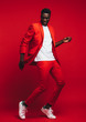 canvas print picture - Man dancing on red background