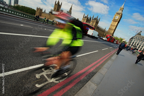 Fast moving London bicycle commuter crossing Westminster Bridge. #273645172