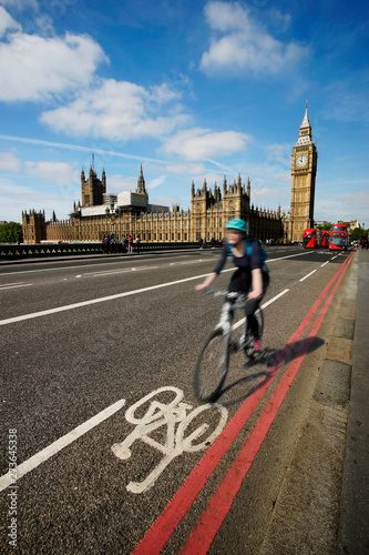 Fast moving London bicycle commuter crossing Westminster Bridge. Canvas Print