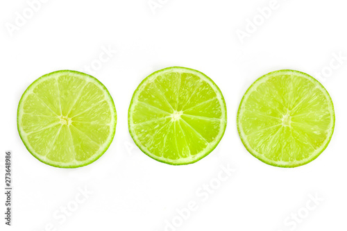 Three vibrant lime slices, shot from the top on a white background