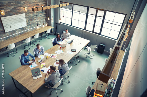 Obraz Young people having business meeting in modern office - fototapety do salonu