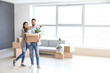 canvas print picture - Young couple with belongings in their new house