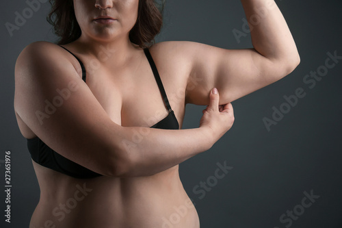 Beautiful plus size woman on grey background Fototapet
