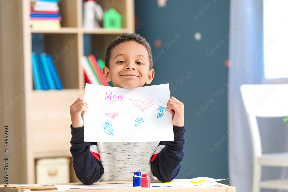 Fototapety, obrazy: Cute African-American boy drawing at home