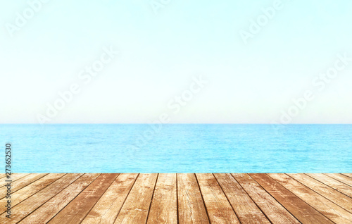Poster Blanc Table top with beach background, sky and cloud in sunny day for product display job showing. Wooden table for display or montage your products.