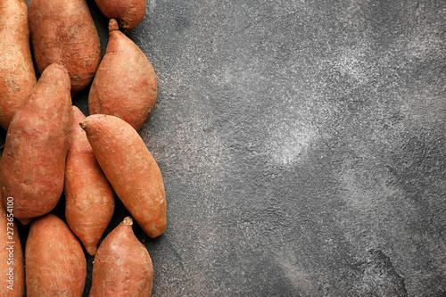Raw sweet potato on grunge background