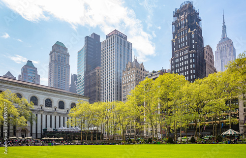 Fototapeta Bryant park, New York, Manhattan. High buildings view from below against blue sky background, sunny day in spring obraz