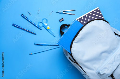 Obraz School backpack with stationery on color background - fototapety do salonu