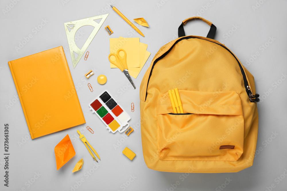 Fototapety, obrazy: School backpack and stationery on light background