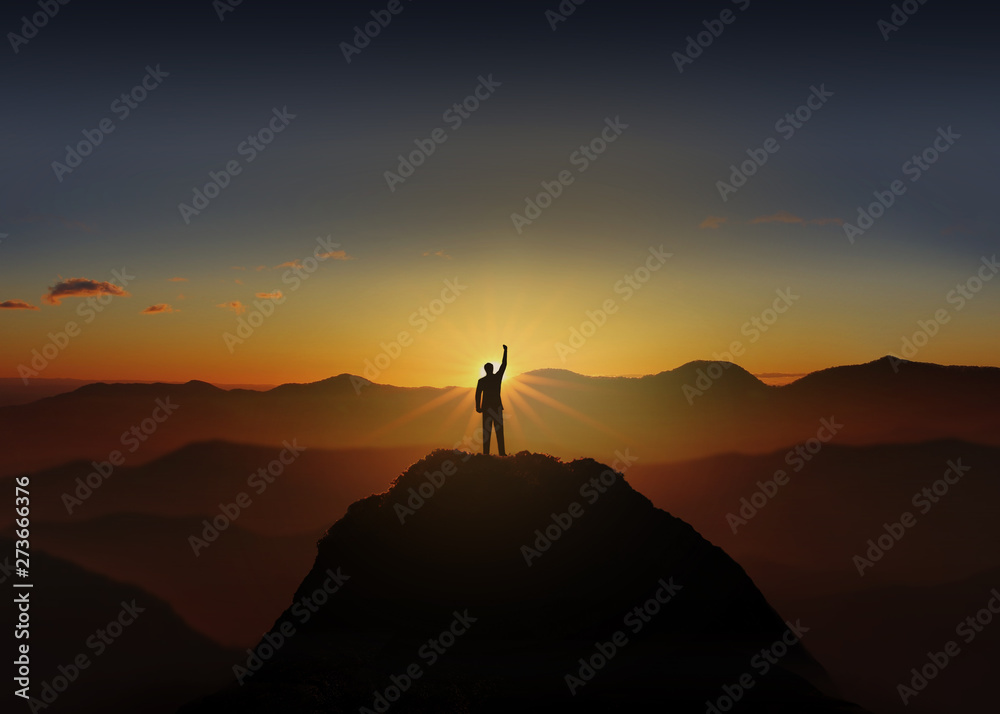 Fototapety, obrazy: Silhouette of Business man Celebration Success Happiness on a mountain top Sunset. Success Concept.