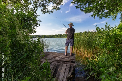 Fotografie, Obraz  angler catching the fish during summer day