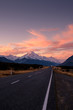 Sunset over the Mount Cook, aka Aoraki , the New Zealand Highest summit, and the road heading to the amazing Hooker Valley and its glacier.