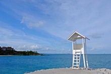 Little Wooden White Life Guard Tower At The Sea On Right Of Frame Seeing The Other Island At A Far,  Khao Laem Ya–Mu Ko Samet National Park, Rayong Province, Thailand.