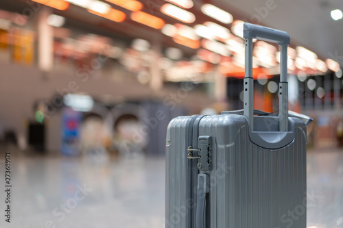 Fotografie, Obraz  luggage holder on suitcase or bag with TRAVEL INSURANCE ,traveling luggages in a