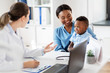 canvas print picture - medicine, healthcare and pediatry concept - happy african american mother with baby son and caucasian doctor at clinic