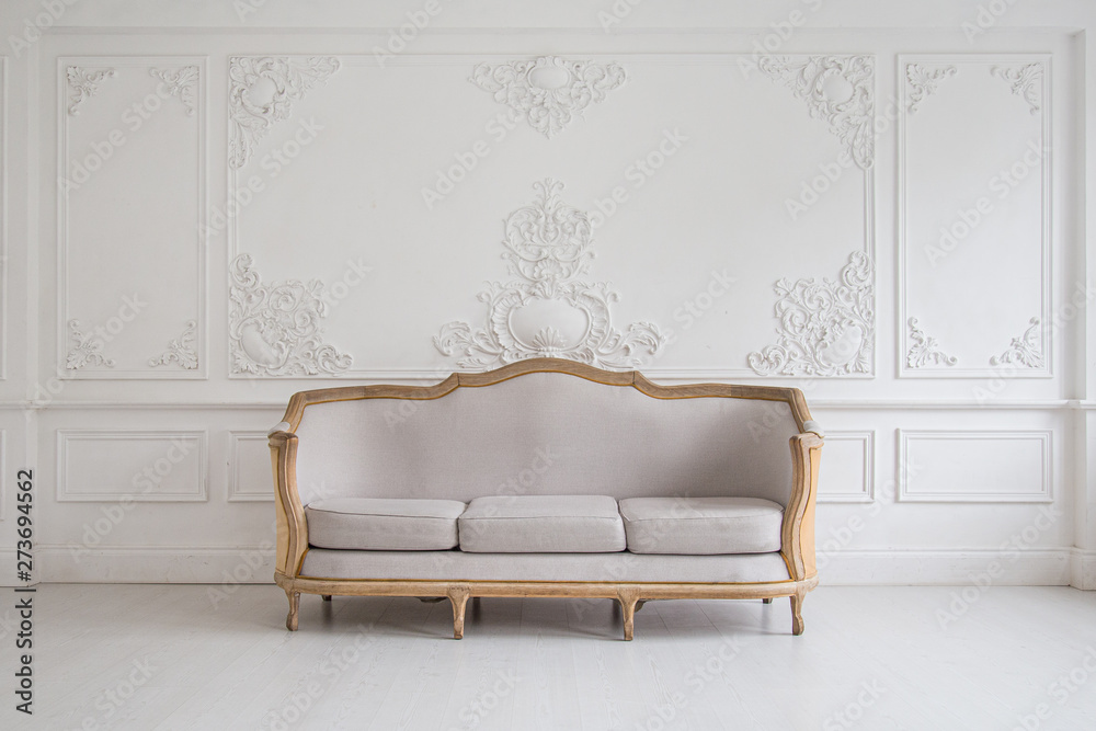 Fototapety, obrazy: Luxurious bright Rococo interior with a large sofa and stucco on the walls. Selective focus.
