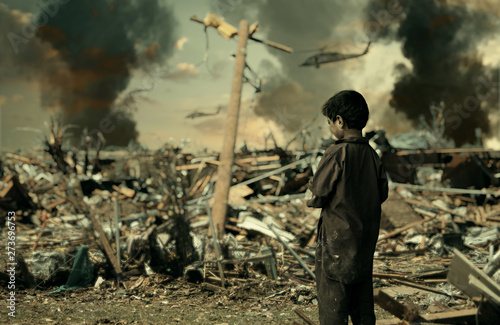 Cuadros en Lienzo  Homeless child crying for his family / Military soldiers killed her family and t