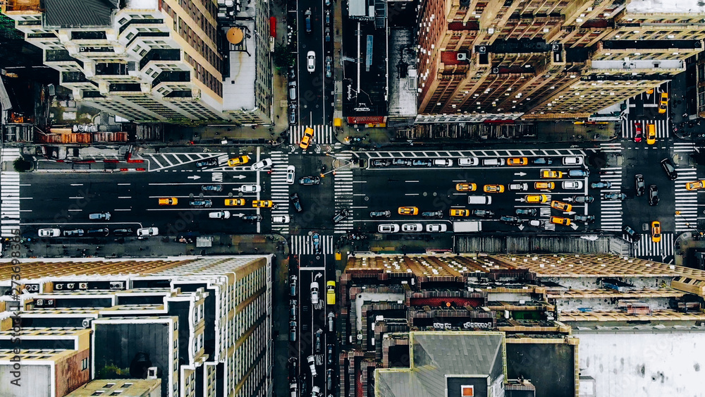 Fototapety, obrazy: Aerial view of New York downtown building roofs. Bird's eye view from helicopter of cityscape metropolis infrastructure, traffic cars, yellow cabs moving on city streets and crossing district avenues
