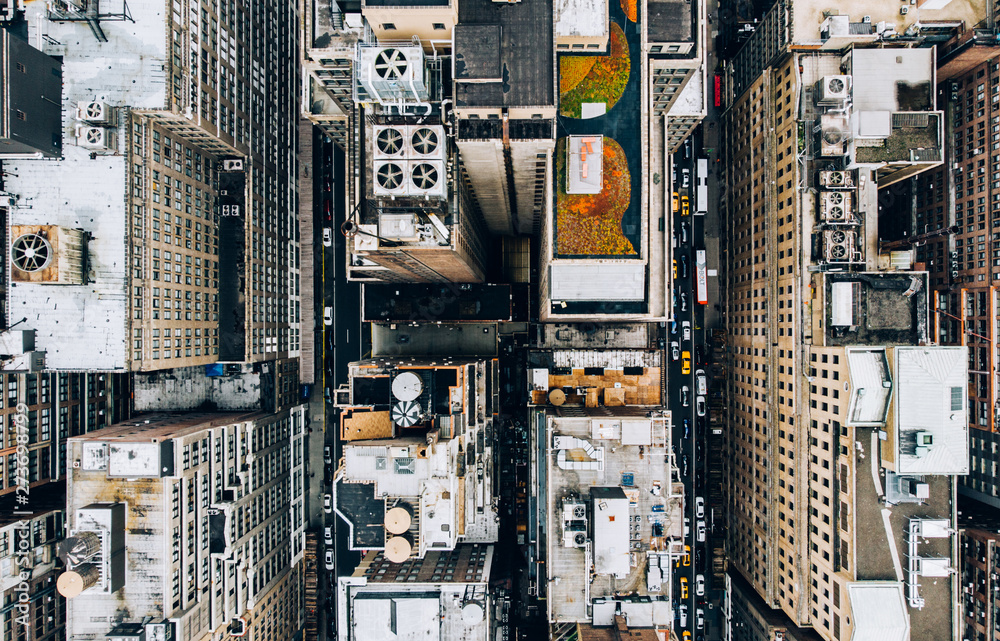 Fototapety, obrazy: Aerial view of New York downtown building roofs with water towers. Bird's eye view from helicopter of cityscape metropolis infrastructure, traffic cars moving on city streets and district avenues