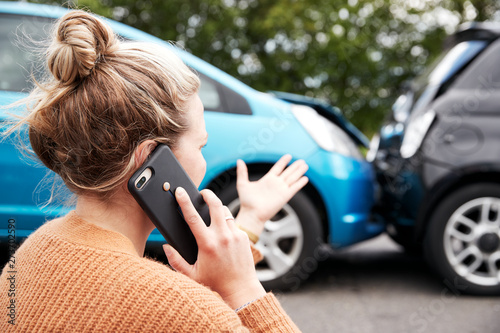 Female Motorist Involved In Car Accident Calling Insurance Company Or Recovery Service - 273702590