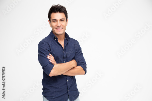 Obraz Portrait of Caucasian man with arms crossed and smile isolated over white background, Looking at camera, Happy feeling concept - fototapety do salonu