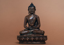 Amitabha Buddha Statue On Brown Background