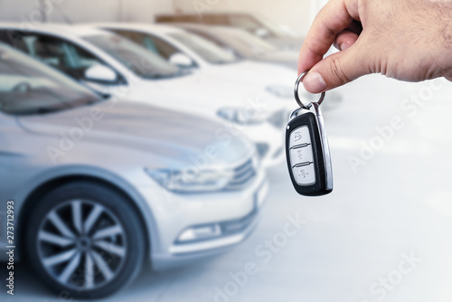 Canvas Prints Textures Man's hand holding car key.Automobile rent or leasing concept.