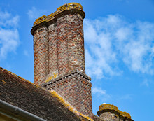 An Old Brick Chimney Stack Ato...