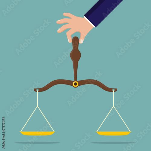 Obraz na płótnie Hand holding justice scale in a flat design