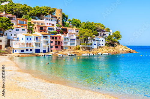Colorful houses in sea bay with beach in Sa Tuna coastal village, Costa Brava, S Fototapet