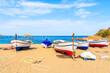 Fishing boats on golden sand beach in Tossa de Mar town, Costa Brava, Spain