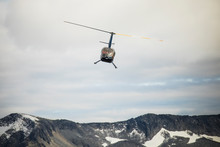 Helicopter Flying Over Mountains, British Columbia.