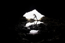 Man Jumping In A Cove In Barbados