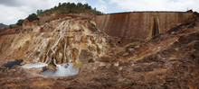 Small Stream Flowing On Sandy Rock On Sunny Day In Long Exposure In Mines Of Riotinto, Huelva