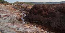 River Stream Across A Rocky Valley In Riotinto