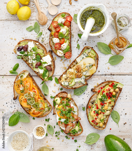 Assorted  open faced sandwiches, Open avocado sandwiches made of  slices of sour Fotobehang