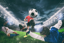 Close Up Of A Football Action Scene With Competing Soccer Players At The Stadium During A Night Match
