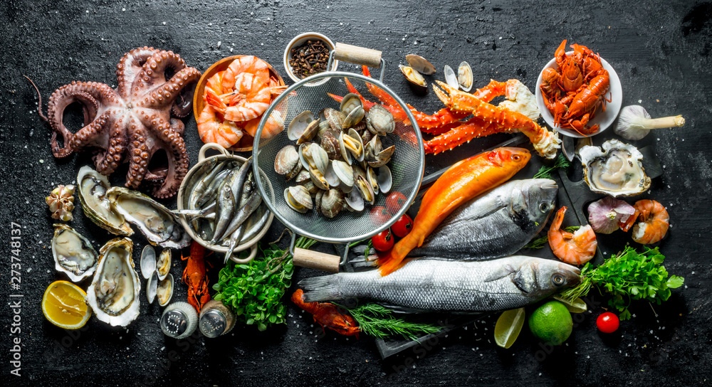 Fototapety, obrazy: Variety of fresh seafood with herbs and lime.