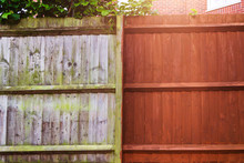 Painting Old Wooden Fence With A Brown Paint, Renovation Concept. Before And After Image