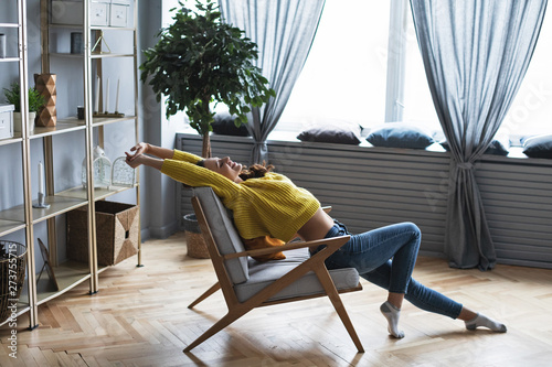 Fotografie, Obraz  Happy woman resting sitting in a comfortable chair.