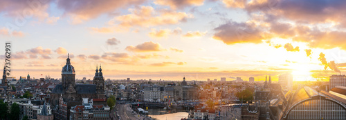 Staande foto Beige Amsterdam skyline panorama historical area at sunst, Amsterdam, Netherlands. Aerial view of Amsterdam, Netherlands.