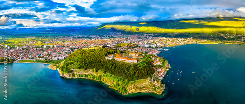 Photo Stands Green blue Samuels Fortress and Plaosnik at Ohrid in North Macedonia