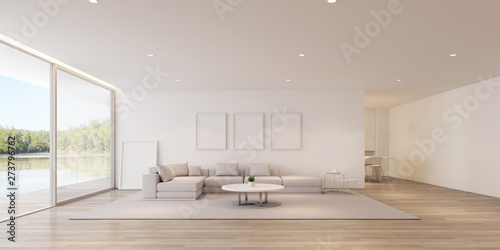 Fototapeta  Perspective of modern luxury living room with sofa and white picture frame on lake view background,Idea of family vacation - warm timber interior design - 3D rendering