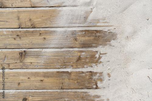 Weathered Wooden Boardwalk on Sand / Aged beach brown wooden floor over summer sand #273814930